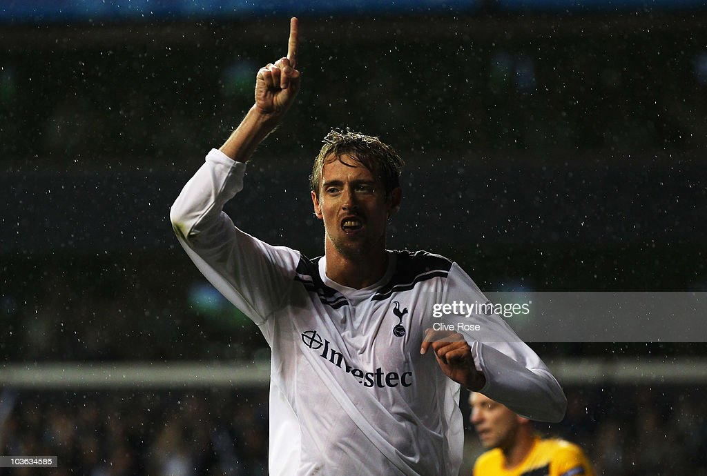 Peter Crouch of Tottenham Hotspur celebrates as he scores their third goal during the UEFA Champions League playoff second leg match between...