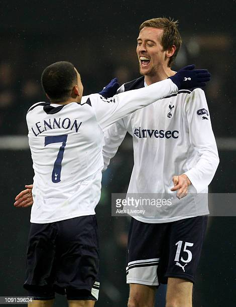 Peter Crouch of Tottenham Hotspur celebrates scoring the winning goal with team mate Aaron Lennon during the UEFA Champions League round of 16 first...