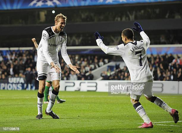 Peter Crouch of Tottenham Hotspur celebrates scoring Tottenham's third goal with Aaron Lennon during the UEFA Champions League Group A match between...