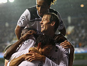 Peter Crouch of Tottenham Hotspur celebrates with team mates as he scores their third goal during the UEFA Champions League playoff second leg match...