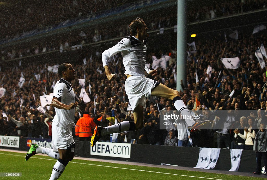 Peter Crouch of Tottenham Hotspur celebrates with Tom Huddlestone as he scores their first goal during the UEFA Champions League playoff second leg...