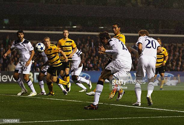 Peter Crouch of Tottenham Hotspur scores their first goal during the UEFA Champions League playoff second leg match between Tottenham Hotspur and BSC...