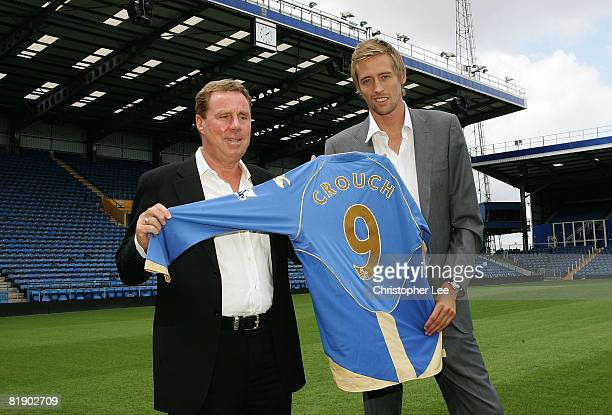 Peter Crouch with manager Harry Redknapp pose with Crouch's new Portsmouth shirt during the press conference to announce the signing of Peter Crouch...