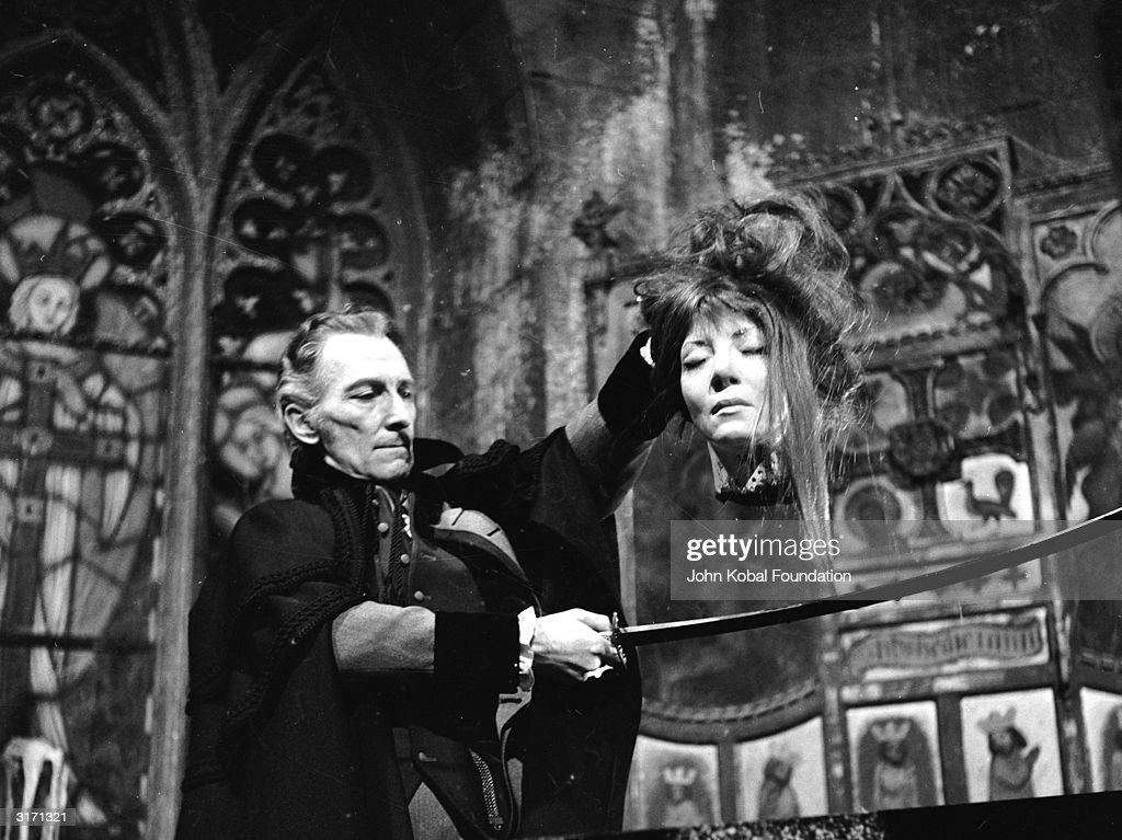 Peter Cushing (1913 - 1994) cuts off the head of a female vampire in a scene from the Hammer horror film 'The Vampire Lovers', directed by Roy Ward Baker.