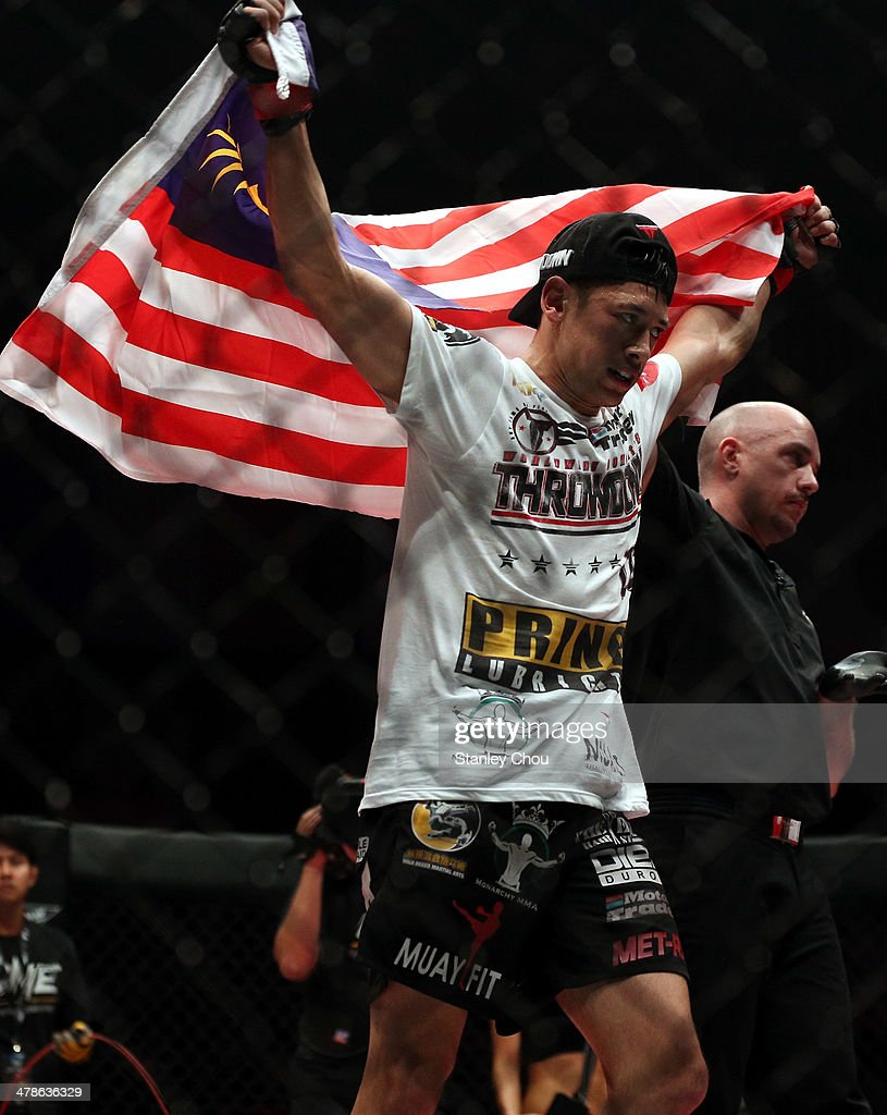 Peter Davis of Malaysia celebrates after he defeated Wagar Umar of Pakistan during the One FC War of Nations bout in the Lightweight Category at...