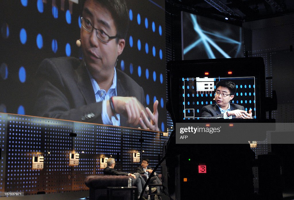 Peter Deng, Facebook Director of Product Management (on camera screen) talks on December 4, 2012 during a session at LeWeb Paris 2012 in Saint-Denis near Paris. AFP PHOTO ERIC PIERMONT