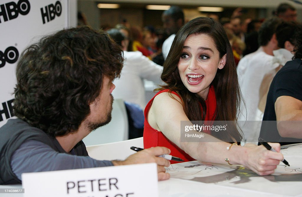 Peter Dinklage and Emilia Clarke attend HBO's 'Game Of Thrones' cast autograph signing at San Diego Convention Center on July 19, 2013 in San Diego, California.