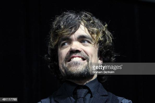 Peter Dinklages poses as he arrives at the Australian premiere of 'XMen Days of Future Past' on May 16 2014 in Melbourne Australia