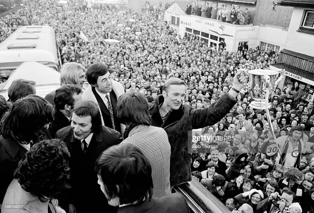 Peter Dobing of Stoke City shows the trophy to the crowd during the team's victory parade through the city of Stoke on Trent after winning the League...
