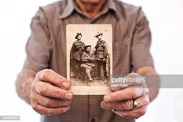 Peter Dowsett son of ANZAC veteran Victor Sydney Dowsett poses with a wartime photograph of father and his uncle Robert William Dowsett on March 30...