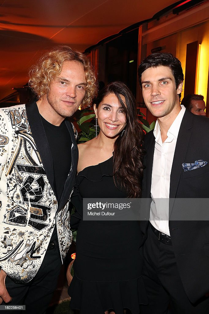 Peter Dundas, Caterina Murino and Roberto Bolle attend The Pucci Dinner Party At Monsieur Bleu In Paris on September 28, 2013 in Paris, France.