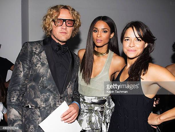 Peter Dundas Ciara and Michelle Rodriguez attend amfAR Milano 2015 at La Permanente on September 26 2015 in Milan Italy