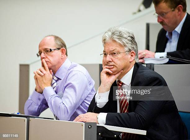 Peter Dunne New Zealand's revenue minister right listens to the opening speech by New Zealand Finance Minister Bill English not pictured at the Tax...