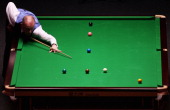 Peter Ebdon of England plays a shot in his Round One match against Ali Carter of England during The Ladbrokesmobile Masters on Day 1 at Wembley Arena...