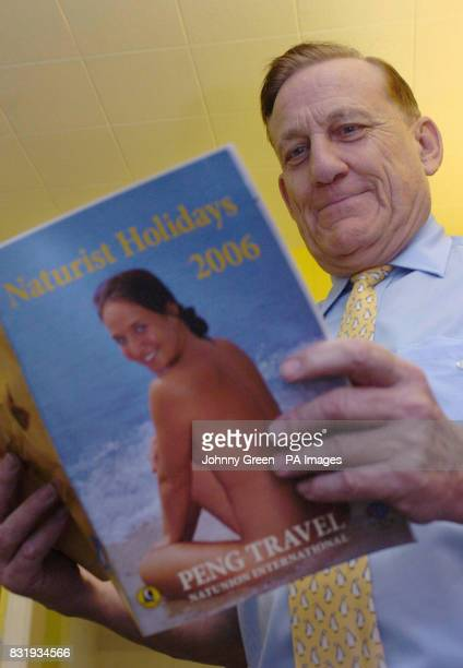 Peter Englert originally hailing from Berlin in Germany reads a Peng Travel Naturist Holidays 2006 brochure inside Peng Travel located at Gidea Park...