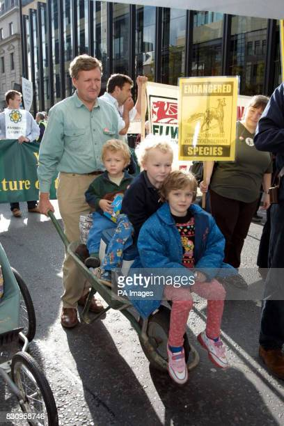 Peter Fernandes from East Anglia pushes his children on in the Liberty and Livelihood march organised by the Countryside Alliance as it passes...