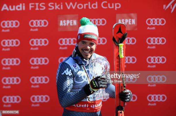 Peter Fill of Italy celebrates with the seasonending globe after winning the overall World Cup Men's Downhill title following the Men's Downhill race...