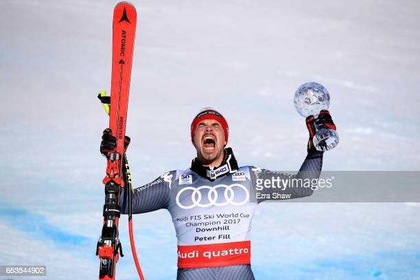 Peter Fill of Italy celebrates with the seasonending globes after finishing second in the Men's Downhill for the 2017 Audi FIS Ski World Cup Final at...