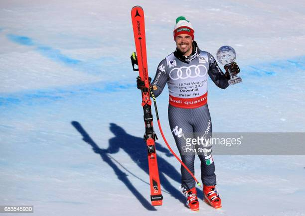 Peter Fill of Italy celebrates with the seasonending globes trophy after finishing second in the Men's Downhill for the 2017 Audi FIS Ski World Cup...