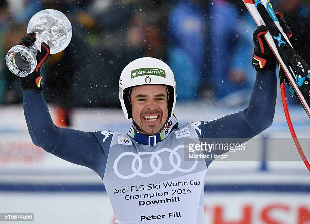 Peter Fill of Italy poses with the Men's World Cup Downhill Crystal Globe trophy after the Audi FIS Alpine Skiing World Cup Men's Downhill Race on...