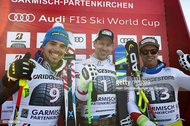 Peter Fill of Italy takes 2nd place Hannes Reichelt of Austria takes 1st place Beat Feuz of Switzerland takes 3rd place during the Audi FIS Alpine...