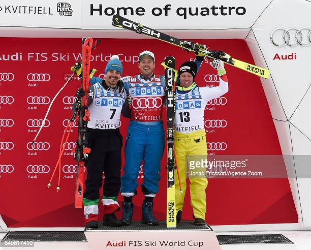 Peter Fill of Italy takes 2nd place Kjetil Jansrud of Norway takes 1st place Beat Feuz of Switzerland takes 3rd place during the Audi FIS Alpine Ski...