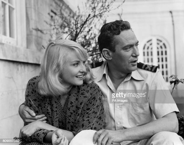 Peter Finch and Diane Cilento stars of the film 'Passage Home' relax in the studio grounds at Pinewood