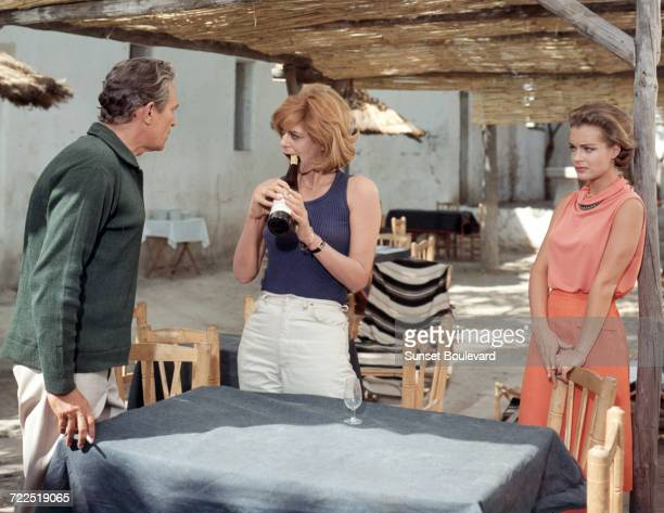 Peter Finch Melina Mercouri and Romy Schneider on the set of '1030 PM Summer' directed by Jules Dassin 1965 Photo by Argos Films/Jorille/Sunset...
