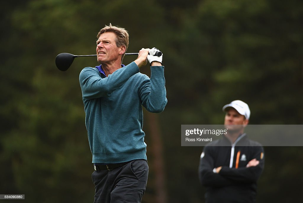 Peter Fleming hits an approach wached by <a gi-track='captionPersonalityLinkClicked' href=/galleries/search?phrase=Robert+Karlsson&family=editorial&specificpeople=214653 ng-click='$event.stopPropagation()'>Robert Karlsson</a> of Sweden during the Pro-Am prior to the BMW PGA Championship at Wentworth on May 25, 2016 in Virginia Water, England.
