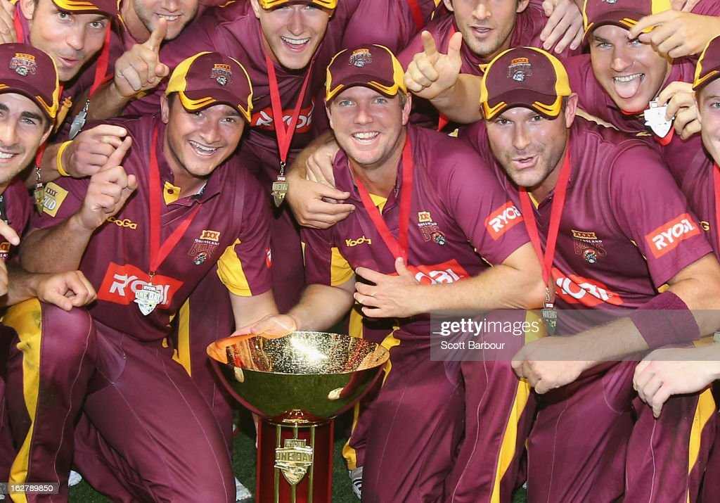 Peter Forrest, James Hopes and Ryan Harris of the Bulls pose with the Ryobi One Day Cup after winning the Ryobi One Day Cup final match between the Victorian Bushrangers and the Queensland Bulls at Melbourne Cricket Ground on February 27, 2013 in Melbourne, Australia.