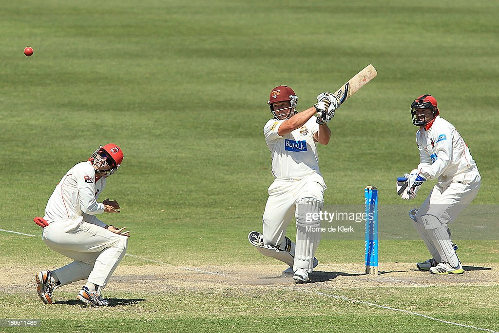 Peter Forrest of the Bulls hits a boundary to bring up his 100 runs during day three of the Sheffield Shield match between the South Australia Redbacks and the Queensland Bulls at Glenelg Oval on November 1, 2013 in Adelaide, Australia.