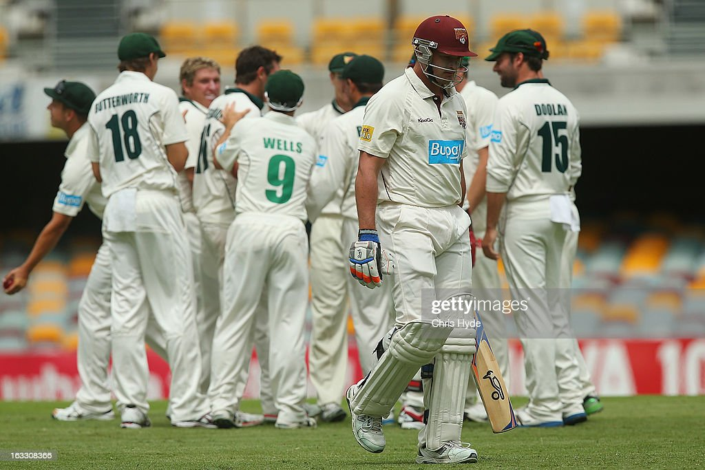 Peter Forrest of the Bulls leaves the field after being dismissed for a duck by Ben Hilfenhaus of the Tigers during day two of the Sheffield Shield match between the Queensland Bulls and the Tasmanian Tigers at The Gabba on March 8, 2013 in Brisbane, Australia.