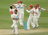 Peter Forrest of the Bulls leaves the field after getting out as Redbacks players celebrate during day two of the Sheffield Shield match between the...