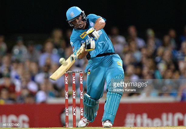 Peter Forrest of the Heat hits the ball to the boundary for a four during the Big Bash League match between the Brisbane Heat and Sydney Sixers at...