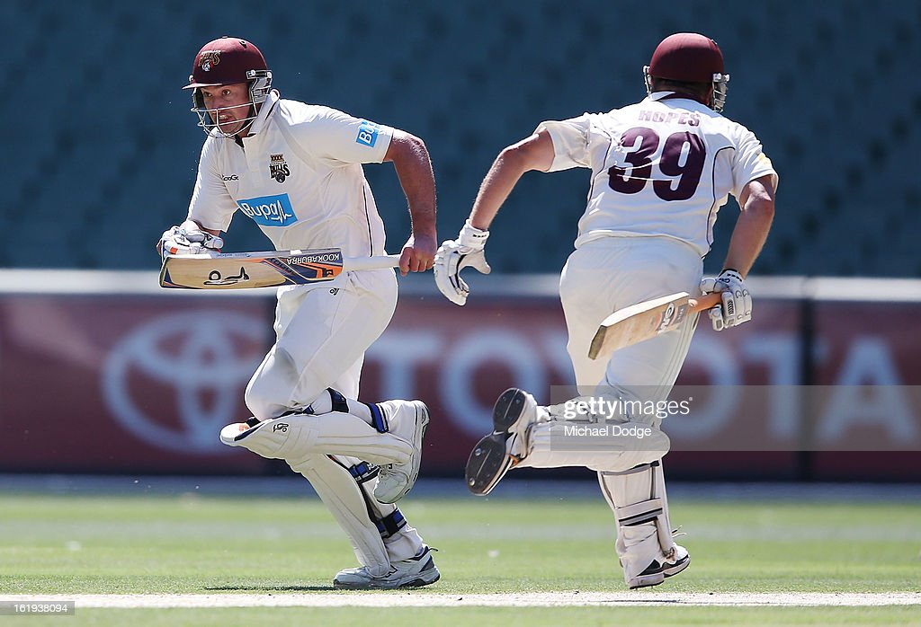 Peter Forrest (L) of the the Queensland Bulls runs with partner James Hopes during day one of the Sheffield Shield match between the Victorian Bushrangers and the Queensland Bulls at Melbourne Cricket Ground on February 18, 2013 in Melbourne, Australia.