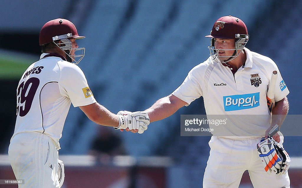 Peter Forrest (R) of the the Queensland Bulls shakes hands with partner James Hopes after his half century during day one of the Sheffield Shield match between the Victorian Bushrangers and the Queensland Bulls at Melbourne Cricket Ground on February 18, 2013 in Melbourne, Australia.
