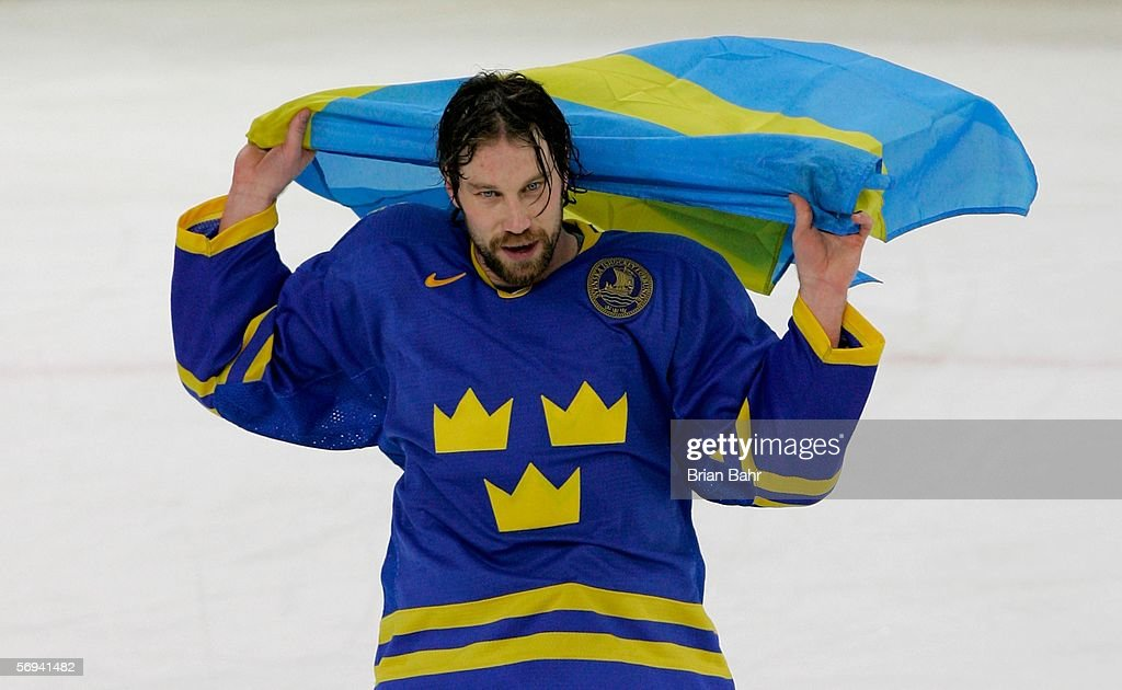 Peter Forsberg of Sweden waves the Swedish flag after Sweden defeated Finland 32 to win the gold medal during the final of the men's ice hockey match...