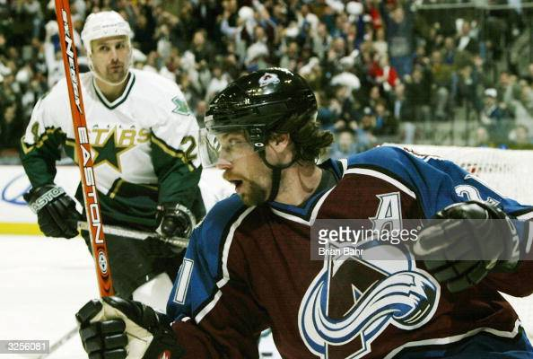 Peter Forsberg of the Colorado Avalanche celebrates a twoonone goal by Alex Tanguay against the Dallas Stars in the first period of the first round...