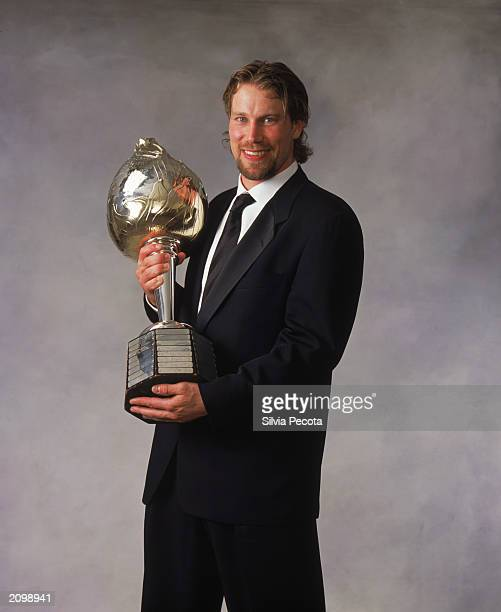 Peter Forsberg of the Colorado Avalanche poses with the Hart Memorial Trophy for MPV during the 200203 NHL Awards at the Convention Centre on June 12...
