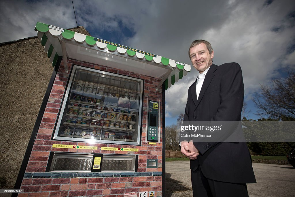 Peter Fox standing beside the giant vending machine he has designed and installed in the tiny Derbyshire village of Clifton The fully automated...