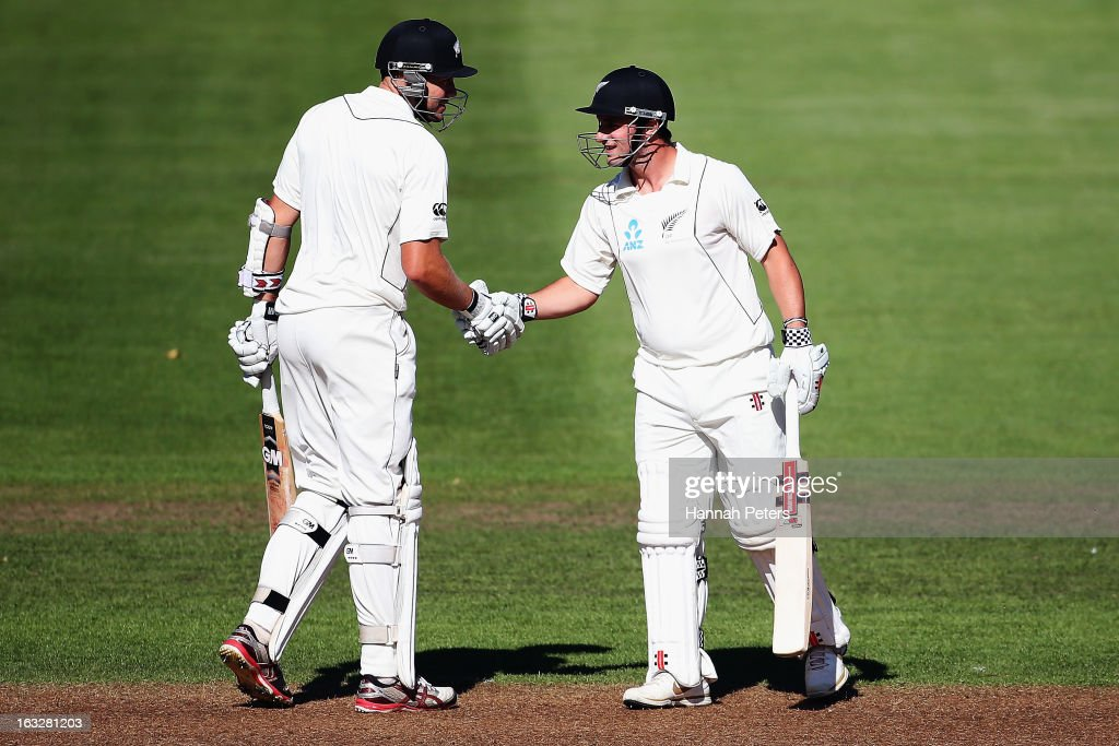 Peter Fulton and Hamish Rutherford of New Zealand congratulate each other on their one hundred run partnership during day two of the First Test match between New Zealand and England at University Oval on March 7, 2013 in Dunedin, New Zealand.