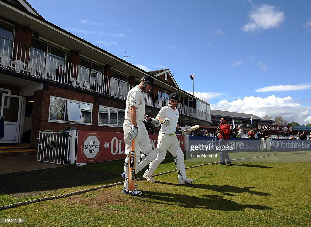 Peter Fulton and Hamish Rutherford of New Zealand take to the field at the start of their match against Derbyshire during the tour match between...