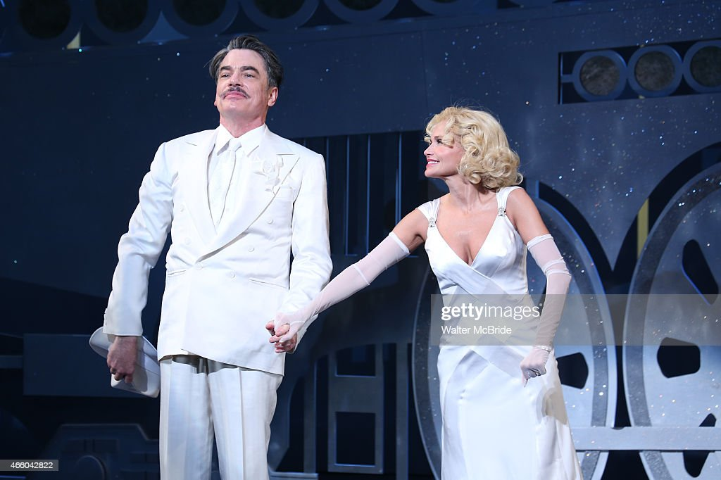 Peter Gallagher and Kristin Chenoweth during the Opening Night Performance Curtain Call for 'On The 20th Century' at the American Airlines Theatre on...