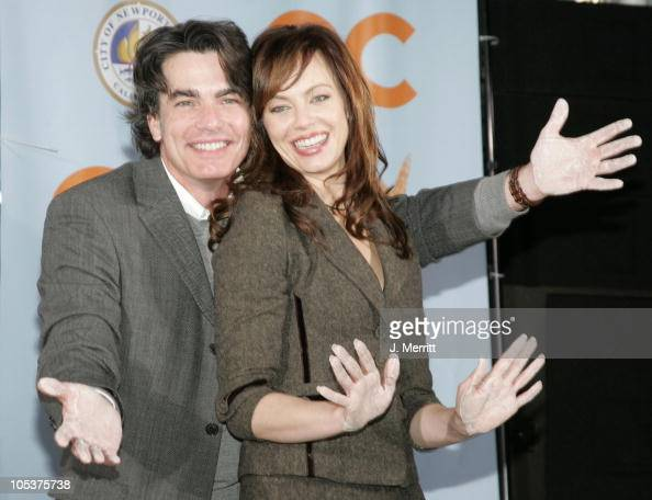Peter Gallagher and Melinda Clarke during Cast And Producers of Fox Hit 'The OC' Receive Key to Newport Beach at The Historic Balboa Pavilion in...