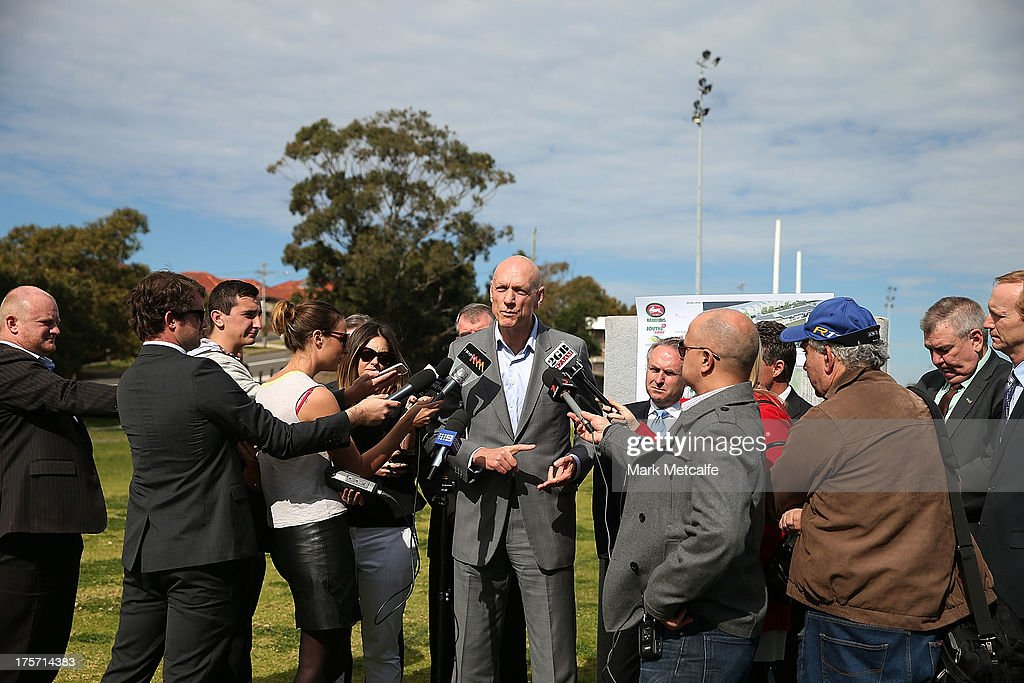 <a gi-track='captionPersonalityLinkClicked' href=/galleries/search?phrase=Peter+Garrett&family=editorial&specificpeople=213494 ng-click='$event.stopPropagation()'>Peter Garrett</a> speaks to the media during a South Sydney Rabbitohs NRL media announcement at Heffron Park on August 7, 2013 in Sydney, Australia.