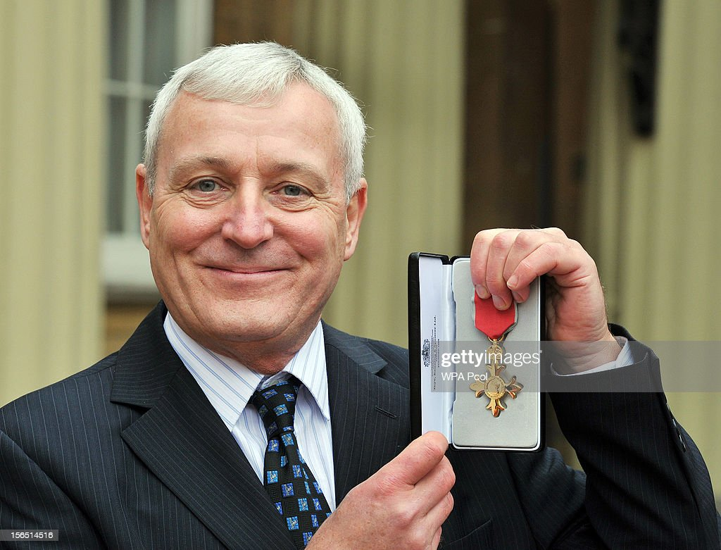 Peter Garrod proudly holds his Officer of the British Empire (OBE), after it was presented to him by Queen Elizabeth II, at the Investiture ceremony at Buckingham Palace on November 16, 2012 in London, England.