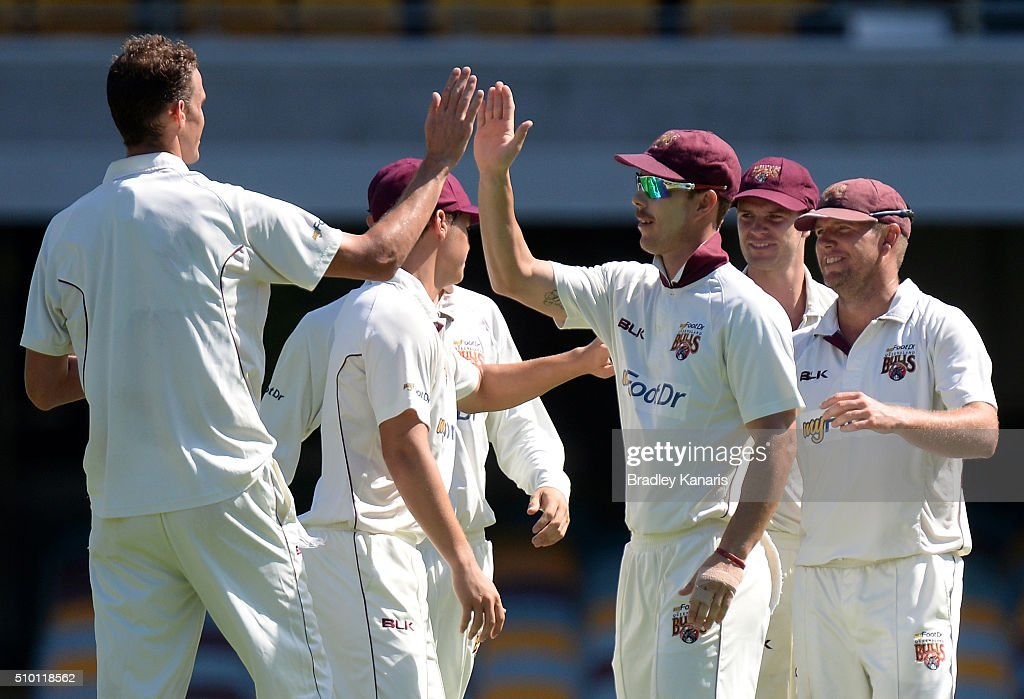 Peter George of Queensland celebrates with his team mates after taking the wicket of <a gi-track='captionPersonalityLinkClicked' href=/galleries/search?phrase=Jordan+Silk&family=editorial&specificpeople=10077485 ng-click='$event.stopPropagation()'>Jordan Silk</a> of Tasmania during day one of the Sheffield Shield match between Queensland and Tasmania at The Gabba on February 14, 2016 in Brisbane, Australia.