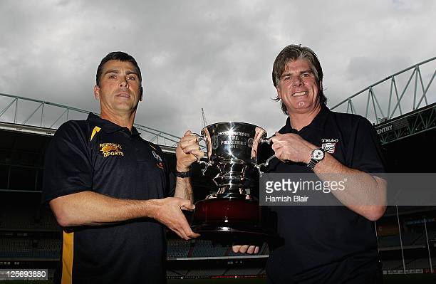 Peter German coach of Williamstown and Gary Ayres coach of Port Melbourne pose with the trophy ahead of their clubs' upcoming Grand Final after the...