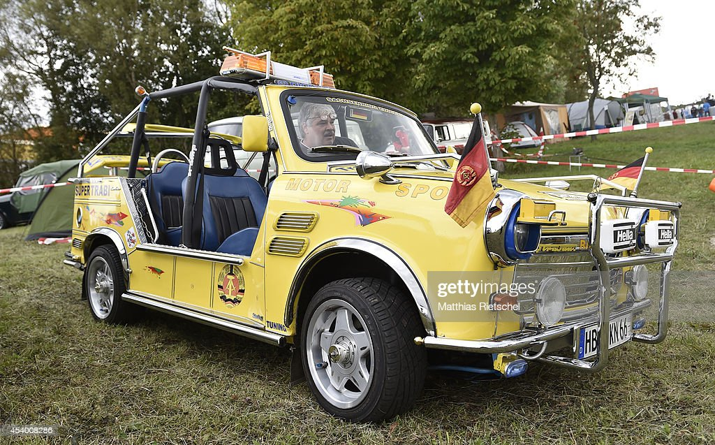 Peter Goebel sits in his 40 horsepower engine Trabant Tramp as fans of the East German Trabant car gather for their 7th annual get-together on August 23, 2014 in Zwickau, Germany. Hundreds of Trabant enthusiasts arrived to spend the weekend admiring each others cars, trading stories and enjoying activities. The Trabant, dinky and small by modern standards, was the iconic car produced in former communist East Germany and today has a strong cult following.