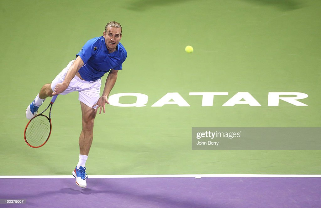 Peter Gojowczyk of Germany in action against Rafael Nadal of Spain in their semifinal during the Qatar ExxonMobil Open 2014 held at the Khalifa...